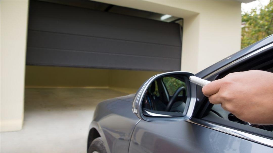 opening_garage_door_with_remote_overhead_door_&_operator_pensacola_9601_n._palafox_st_ste_6-a_pensacola_florida_32534.jpg