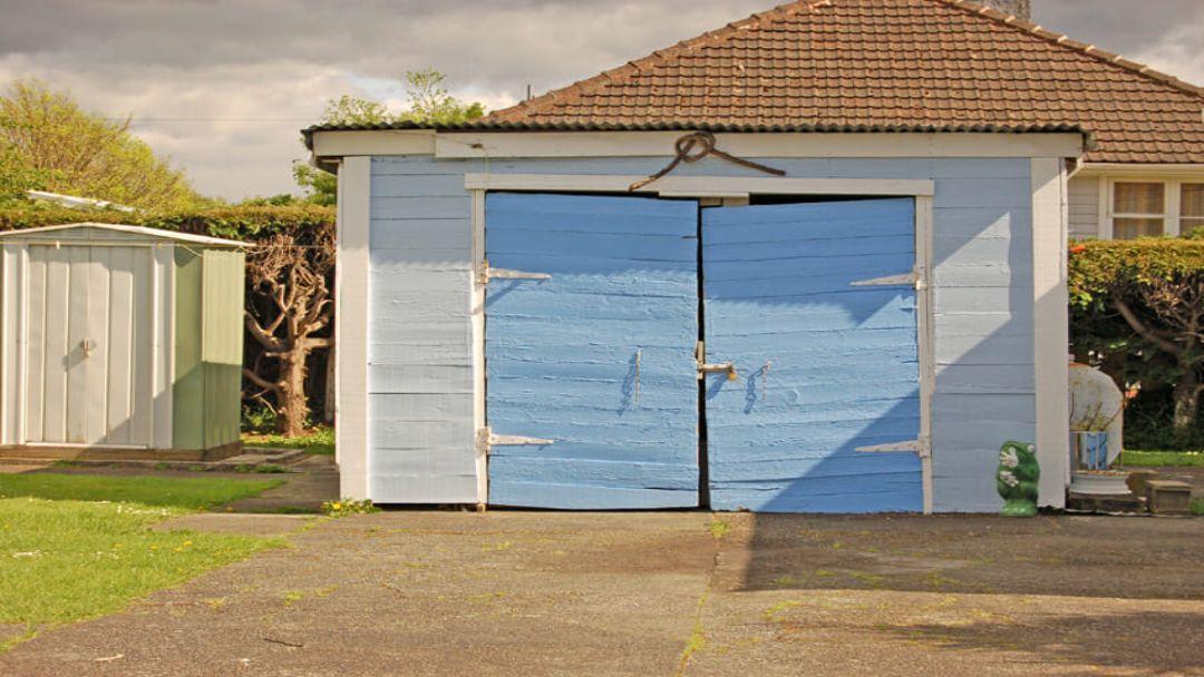 damaged_garage_door_-_overhead_door_&_operator_pensacola_9601_n._palafox_st_ste_6-a_pensacola_florida_32534.jpg