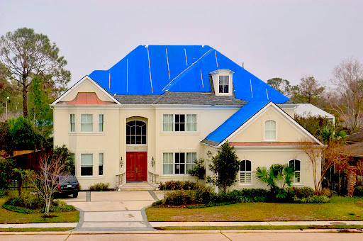 roof_damage_-_roofing_tarp_-_storm_damage_-_freeman_roofing.jpg