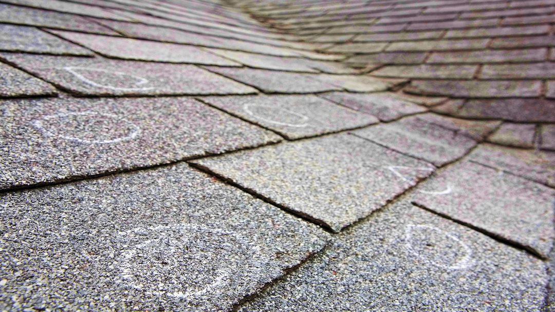 roof_damage_-_new_roof_-_shingles_-_freeman_roofing.jpg