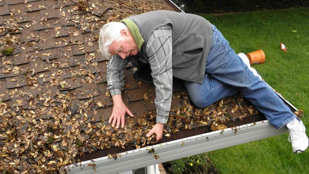 man_on_roof_cleaning_gutters__gutter_solutions_and_home_improvements_https-::bit.ly:3jywyst__(850)_776-1782_.jpg
