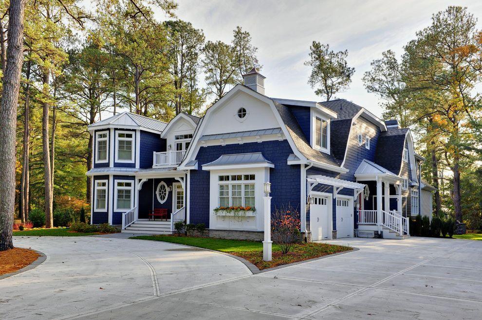 slate-blue-vinyl-siding-beach-style-exterior-also-balcony-blue-house-carriage-doors-driveway-gambrel-lantern-metal-roof-standing-seam-roof-trellis-white-trim-window-boxes-wood-siding.jpg