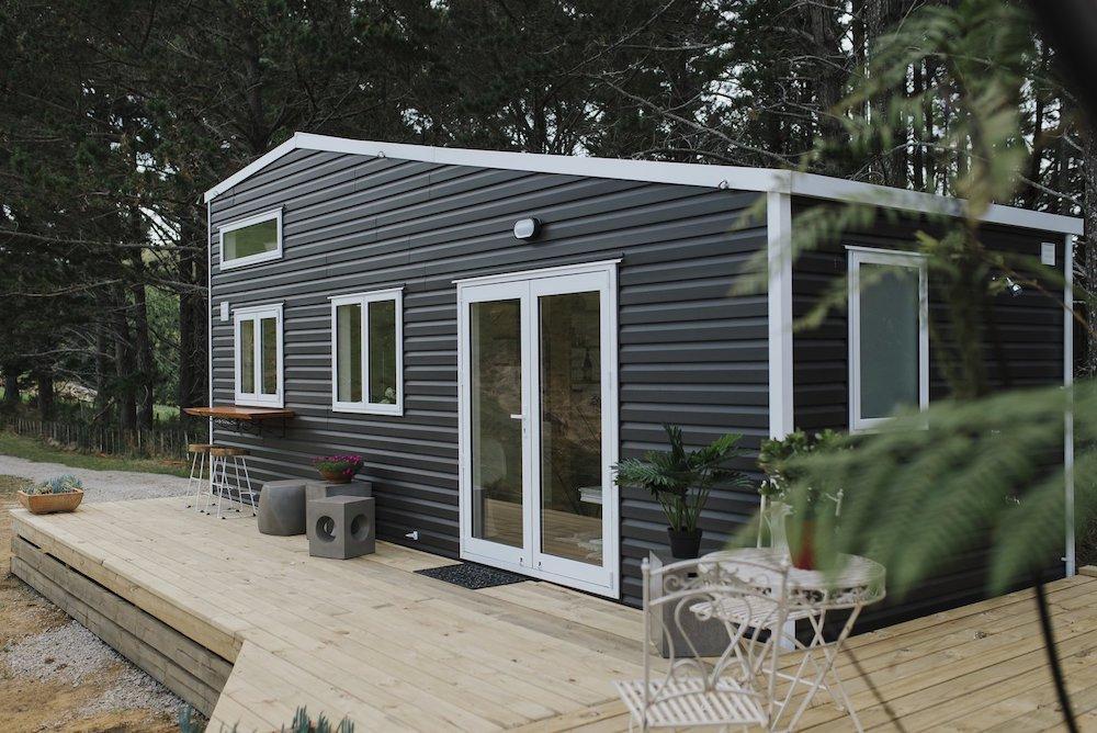 tiny_house_vinyl__gutter_solutions_and_home_improvements_https-::g.page:guttersolutionshomeimprovements?share_(850)_776-1782.jpg