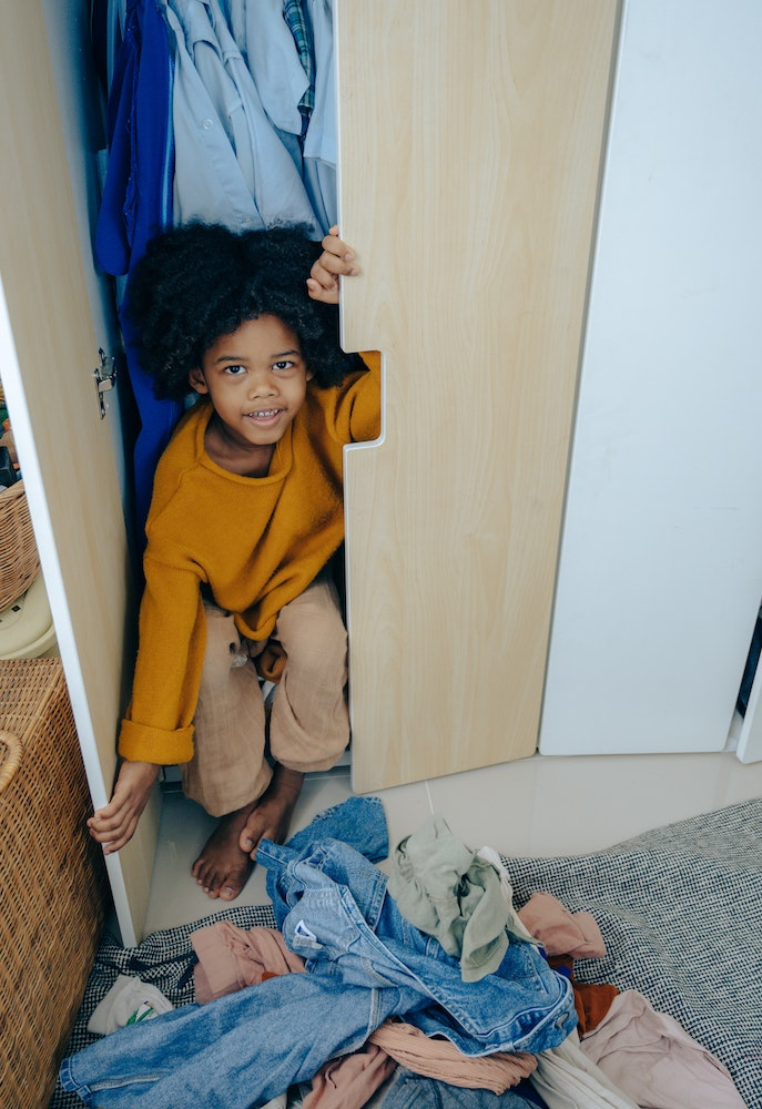 child_in_closet__something_old_salvage_(s.o.s.)_6505_north_w_st.___pensacola__fl_32505_850-758-9900_https-::www.somethingoldsalvage.com.jpg