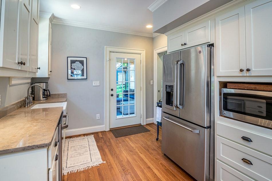 wood_kitchen_floor__gutter_solutions_and_home_improvements_https-::seamlessgutterspensacola.com:gutter-services:_(850)_776-1782.jpg