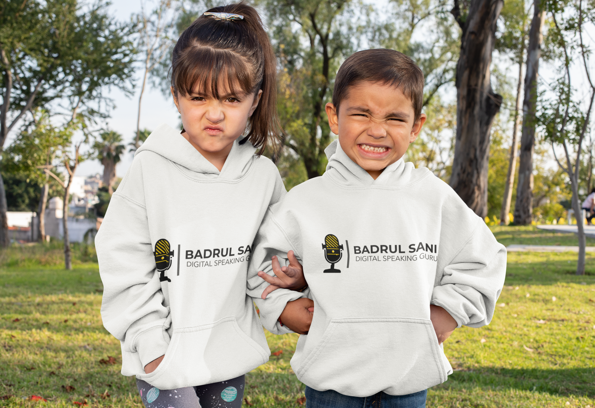 mockup-of-brother-and-sister-wearing-hoodies-at-the-park-31669.png