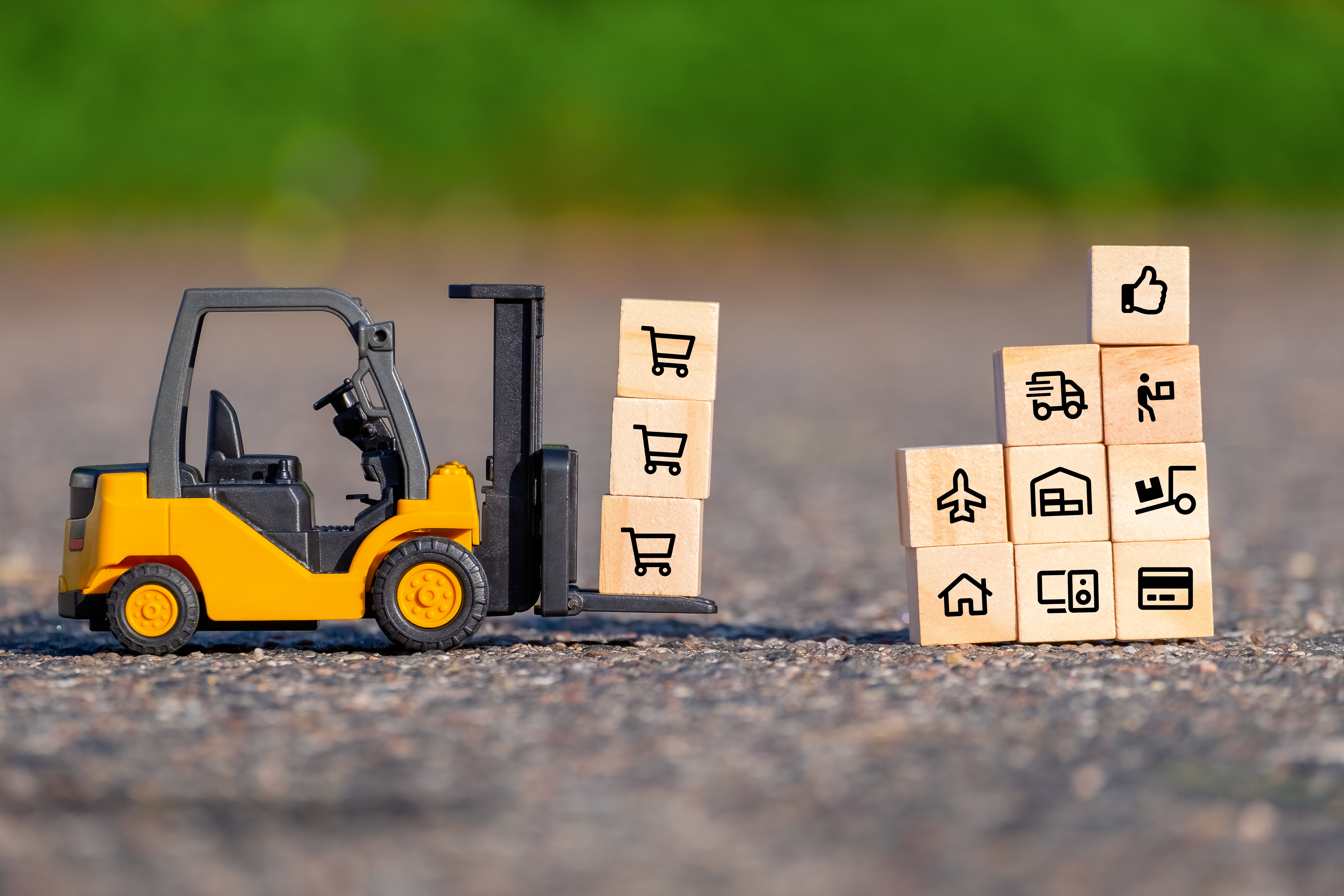 mini-forklift-truck-moves-pallet-with-wooden-block-with-icons.jpg